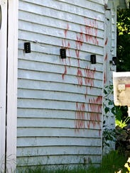 Racist graffiti adorned the side of a garage at a home