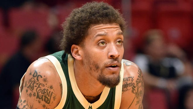 Milwaukee Bucks forward Michael Beasley (9) rests during the first half against the Miami Heat at American Airlines Arena. Mandatory Credit: Steve Mitchell-USA TODAY Sports