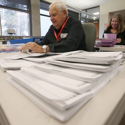 Inslee OKs prepaid ballot postage for 2018 elections