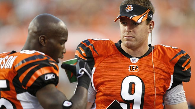 CINCINNATI - AUGUST 31:  Carson Palmer #9 and Chad Johnson #85 of the Cincinnati Bengals talk on the sideline during a NFL preseason game against the Indianapolis Colts on August 31, 2007 at Paul Brown Stadium in Cincinnati, Ohio. (Photo by Joe Robbins/Getty Images)