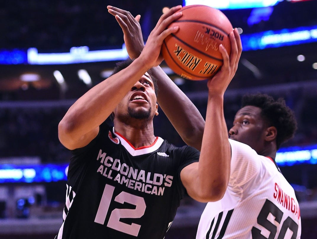 UK-bound guard Isaiah Briscoe (12) shoots the ball against center Caleb Swanigan (50) during the first half of the McDonald's All America Game.