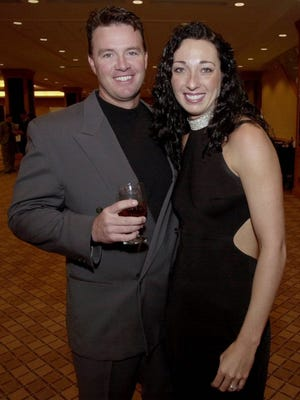 March 1, 2001: Six-time Olympic gold medalist swimmer Amy Van Dyken, right, and Denver Broncos punter Tom Rouen pose before going into the Colorado Sports Hall of Fame dinner in Denver. (AP Photo/David Zalubowski, File)