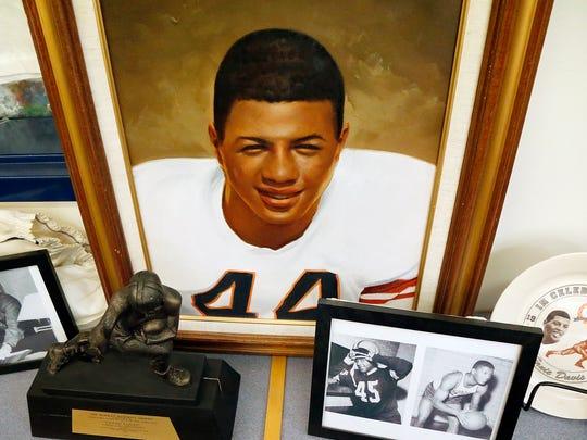 A portrait of Ernie Davis sits behind a Heisman Memorial Trophy and pictures of the Elmira football player in Brendan Walker's Ernie Davis mobile museum March 3 at Hendy Elementary School in Elmira.