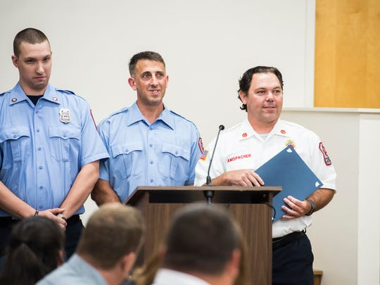 Captain Charles Amspacher and eleven other firefighters are awarded the Departmental Unit Citation Award during the Hanover Area Fire and Rescue commendation awards ceremony at the Penn Township Municipal Center on June 21, 2018.