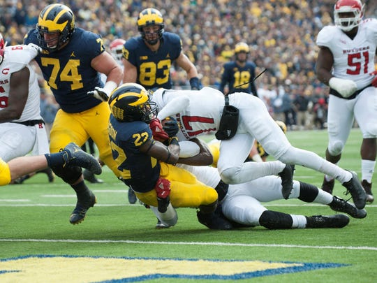 Michigan running back Karan Higdon findS the end zone for a touchdown in the second quarter to put UM up 14-7 on Saturday. Fullback Ben Mason made a tremendous block on the run.