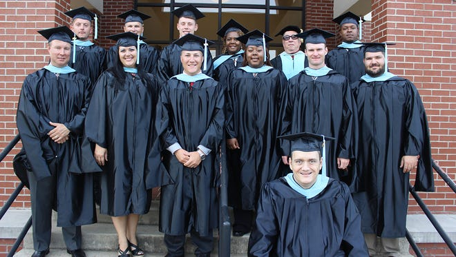 William Carey University's inaugural cohort of students in the Master of Education in Interscholastic Athletic Administration program graduated during fall commencement exercises on Saturday, August 9. Pictured are (first row) Kevin Mauldin; (second row, left to right) Randall Mosbee, Amanda Harrelson, Eric Dyess, Kenoshia Funchess, Kevin Graham and Yancey Lott; and (back row, left to right) Rory Lynch, Shane Kelly, Elliot Dyke, Shirley Funchess, Dr. Walter Cooper and Kenneth Morgan.