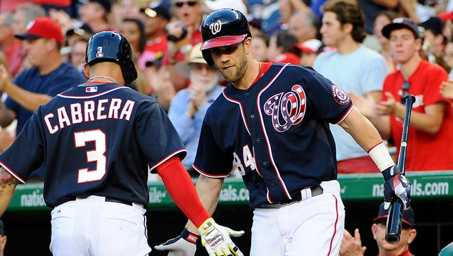 Asdrubal Cabrera is congratulated by Bryce Harper after scoring a run in the first inning at Nationals Park.