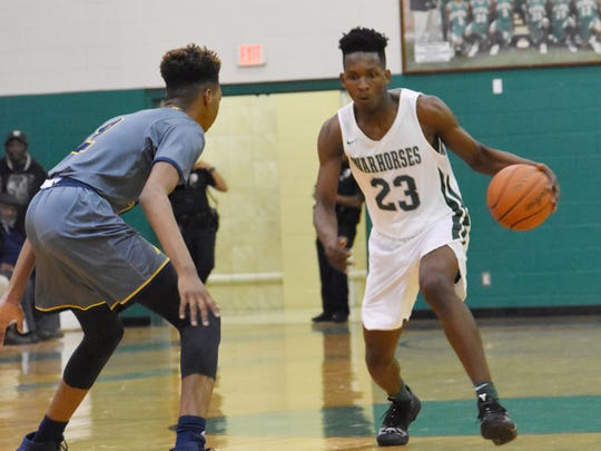 Peabody senior Darius Smith (23) tries to drive for two points. Peabody Magnet High School defeated Carencro High School 98-62 at the Emerald Palace Tuesday, Dec. 11, 2018.