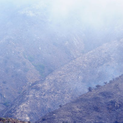 The blackened mountainsides of Garrapata Park after