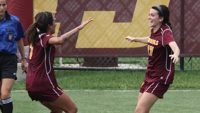 Lucy Lara (left) and Cali Farquharson celebrate one of Farquharson's goals Sunday at Loyola Chicago.