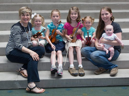 The American Suzuki Institute is a special time for Stephanie Price, left, to spend with her grandchildren (from left) Elise, Daryn, Claire and Audrey Thiel, and daughter Krystle Thiel holding Bridget. The two-week institute is held annually at UW-Stevens Point.