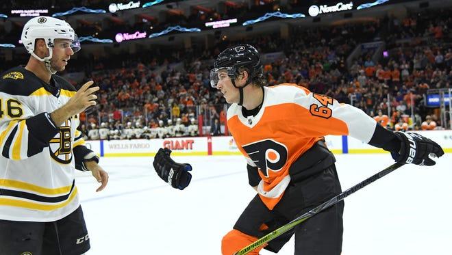 Boston Bruins center David Krejci (46) and Philadelphia Flyers center Nolan Patrick (64) drop the gloves.