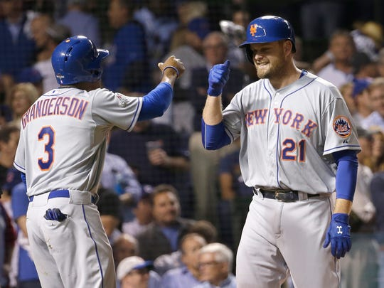 New York Mets' Lucas Duda is congratulated by Curtis Granderson after hitting a three-run home run during the first inning of Game 4 of the National League baseball championship series against the Chicago Cubs Wednesday, Oct. 21, 2015, in Chicago.