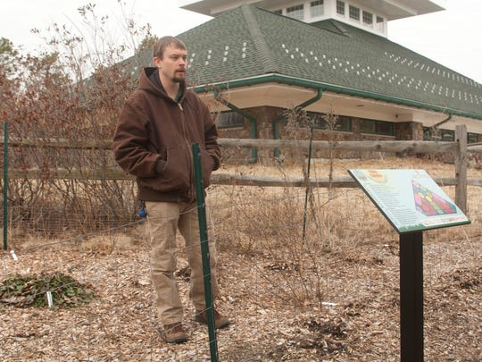 Jason Hoger, senior park naturalist in the Ocean County Department of Parks and Recreation, talks about the rain garden to soak up water that comes off the roof of the visitor's center at Jakes Branch County Park in Beachwood.