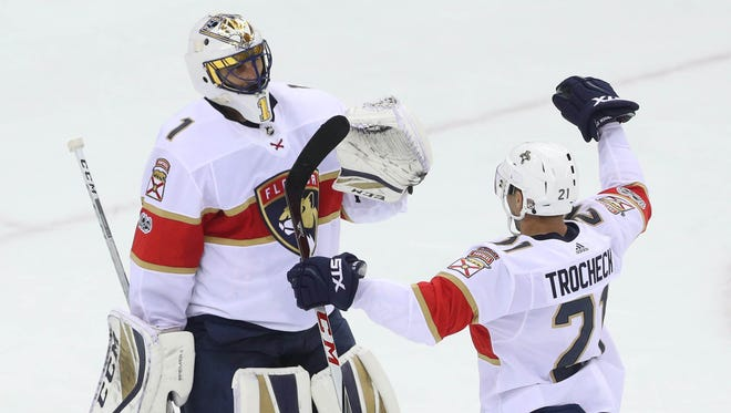 Panthers goalie Roberto Luongo, left, and teammate Vincent Trocheck celebrate the Panthers' win over the Devils at Prudential Center in Newark, N.J.