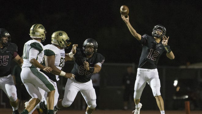 Hamilton's Tyler Shough throws a long completion against Skyline in the first half at Hamilton High School on September 23, 2016 in Chandler.