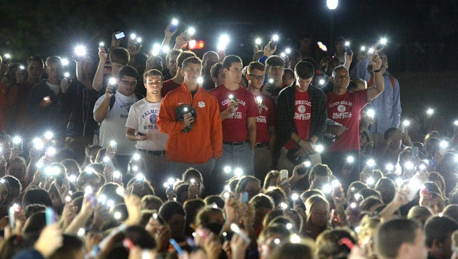 Clemson students hold cell phones during a vigil on Clemson's Bowman Field Tuesday, September 23, 2014 for fellow student Tucker W. Hipps who's body was found yesterday in Lake Hartwell.