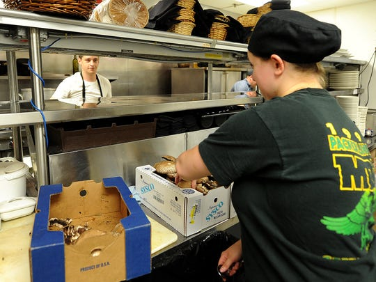 Korina Schroeder, a line chef at Black and Tan Restaurant,