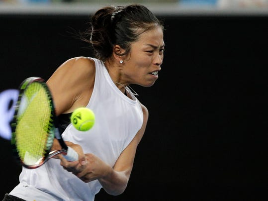 Taiwan's Hsieh Su-wei makes a backhand return to Poland's Agnieszka Radwanska during their third round match at the Australian Open tennis championships in Melbourne, Australia, Saturday, Jan. 20, 2018. (AP Photo/Dita Alangkara)