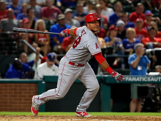 Los Angeles Angels' Carlos Perez (58) follows through on a run-scoring double to right in the seventh inning of a baseball game against the Texas Rangers on Monday, Sept. 19, 2016, in Arlington, Texas. The Angels' Jefry Marte scored on the hit. (AP Photo/Tony Gutierrez)