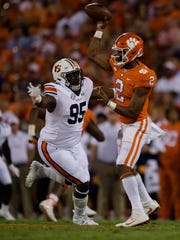 Clemson quarterback Kelly Bryant (2) throws as Auburn defensive lineman Dontavius Russell (95) pressures him during the NCAA football game between Auburn and Clemson on Saturday, Sept. 9, 2017, in Clemson N.C.
