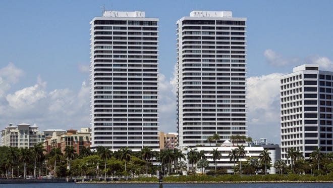 The twin towers on Flagler Drive in downtown West Palm Beach, which no longer have the Trump Plaza sign atop the buildings.