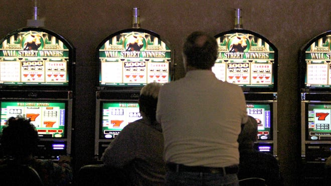 Patrons play on the video gaming units at Empire City Casino at Yonkers Raceway.