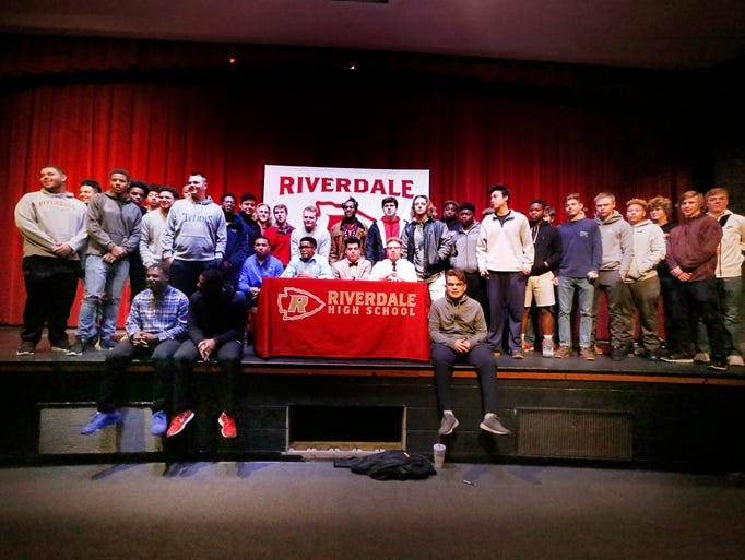The Riverdale football team has their picture taken