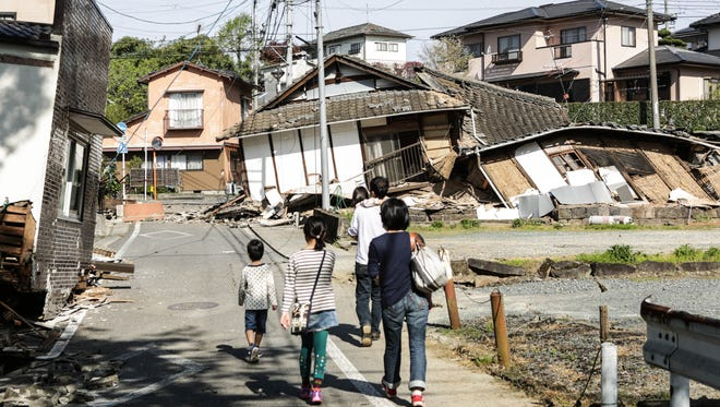 Houses are seen destroyed by a recent earthquake on April 16, 2016 in Kumamoto, Japan.