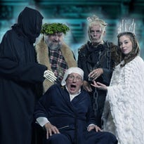 "Fiona Colson as Tiny Tim and Keith Mino as Ebenezer Scrooge in Riverwalk Theatre's version of ""The Christmas Carol""."