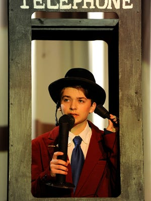 "Chillicothe High School 10th-grader Joey White plays the role of Nathan Detroit as he and other cast members rehearse their production of ""Guys and Dolls."""