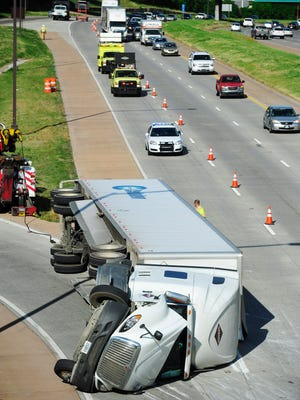 A truck entering I-440 East rolled over into the interstate closing it for hours early Tuesday morning