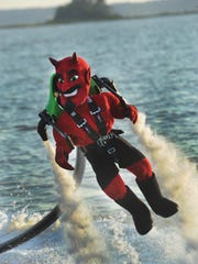 One of the items is the new Dewey Devil mascot for the bar northbeach (125 McKinley St, Dewey Beach). It's a dude in a giant red devil costume. Everyone once in a while they rent a jetpack that the mascot uses in the bay just off the shoreline at the restaurant. It allows him to fly about 20 feet in the air by recycling the water through a hose.