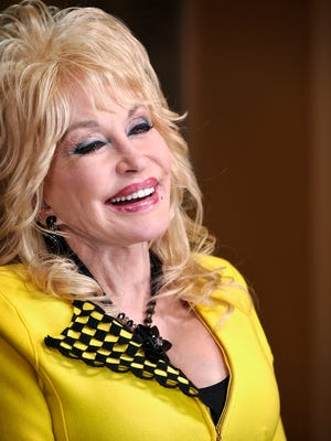 """""""It does make you feel good to know you had a hand in doing a great thing for a whole lot of people,"""" Dolly Parton says of her Pigeon Forge, Tenn., theme park."""