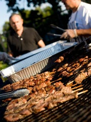 Pork tenderloin shish kebobs grill during the Greek Festival at the Holy Trinity Orthodox Church in Wilmington