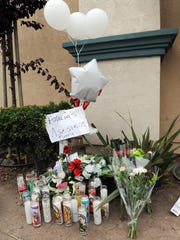 Flowers are placed at a shrine at the site where Salinas police officers fatally shot Carlos Mejia at the corner of Del Monte Avenue and North Sanborn Road in Salinas on May 20, 2014.