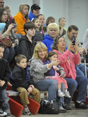 Families watch animals during a circus' local appearance in 2013.