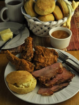Batch of biscuits served with fried chicken and sliced ham are a delicious addition to any table — morning, noon or night.