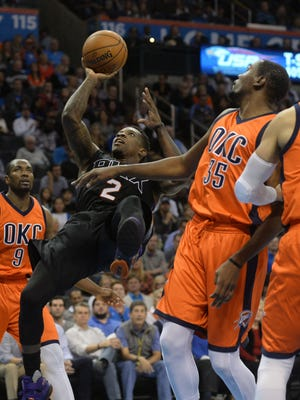 Nov 8, 2015: Phoenix Suns guard Eric Bledsoe (2) shoots the ball against Oklahoma City Thunder forward Kevin Durant (35) during the first quarter at Chesapeake Energy Arena.