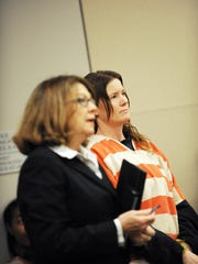 Tami Huntsman, right, and defense attorney Kay Duffy listen to instructions at the Monterey County Courthouse on Wednesday morning in Salinas.