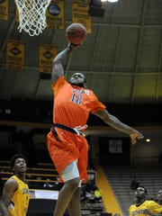 UTEP's Terry Winn (12) goes up for a dunk against Southern