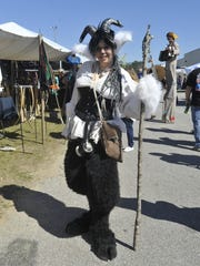 Stephanie Crouse poses in her Satyr costume at the 15th annual Gulf Coast Renaissance Faire and Pirate Festival Saturday.