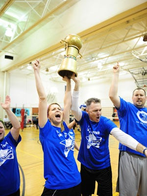 Principals Chris Suliman and Mark Watson celebrate victory with the roaring crowd.