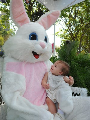Jocelyn Rawls visits the Easter bunny at Simple Church's Easter activities held at Bossier City's CenturyLink Center.