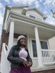 Erica Carter, 21, stands outside the house she shares with her family on Lantz.