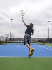 Mitch Rice serves on a new court that is part of the new Southeast Polk tennis facility.Mark Davitt/Special to the Herald-index