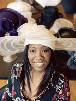 """Danielle DeLaine, of Florence, quit her career as a financial consultant and stock trader to design hats about a year ago. Derby hats are her favorite to design, because """"anything goes."""""""