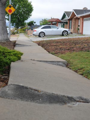 Uneven sidewalks in north Salinas, photographed on Tuesday, May 24th, 2016.