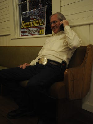 Dennis Smith waits for the results of Tuesday's election
