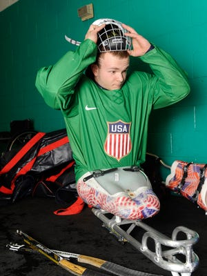 U.S. Paralympic Sled Hockey Team athlete Josh Pauls readies his equipment prior a practice at the Sertich Ice Arena on Feb. 26, 2014 in Colorado Springs, Colorado.